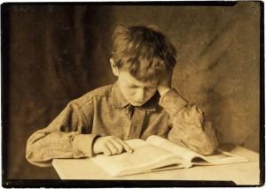 800px-Lewis_Hine,_Boy_studying,_ca._1924